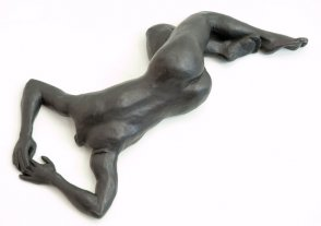 cranial dorsal view of bronze sculpture of a female nude lying down