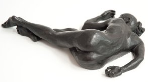 caudal dorsal view of bronze sculpture of a female nude lying down