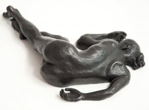 dorsal view of bronze sculpture of a female nude lying down