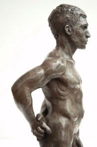 lateral view of trunk of bronze sculpture of male nude standing figure
