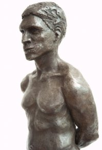 lateral frontal view of bust of bronze sculpture of male nude standing figure