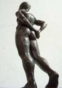 caudal lateral dorsal view of bronze sculpture of standing male nude figure