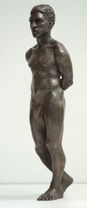 frontal lateral view of bronze sculpture of male nude standing figure