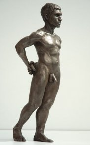 lateral frontal view of bronze sculpture of male nude standing figure