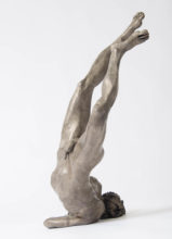 bronze sculpture of Icarus hitting the ground